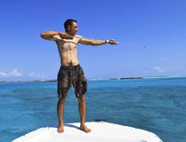 Guide Dreko Chamberlain demonstrates how to use a spear for fishing in the Exumas. STEVE MACNAULL PHOTO