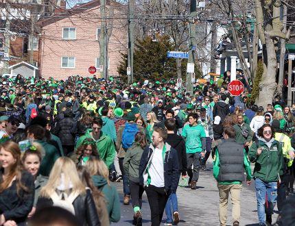 Masses of St. Patrick's Day revellers move along Aberdeen Street from Earl Street to Johnson Street near Queen's University in Kingston. (Steph Crosier/Whig-Standard file photo)