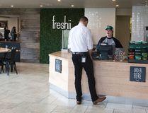 A Freshii staff serves a customer at shop in London, Ont. on November 6, 2015. Derek Ruttan/The London Free Press/Postmedia Network
