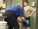 A TSA agent pats-down a boy at a Texas airport.