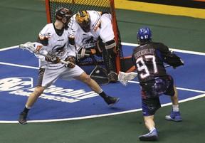 Rock'S Reid Reinholdt fires a shot at New England Black Wolves' Evan Kirk. (Jack Boland/Toronto Sun)