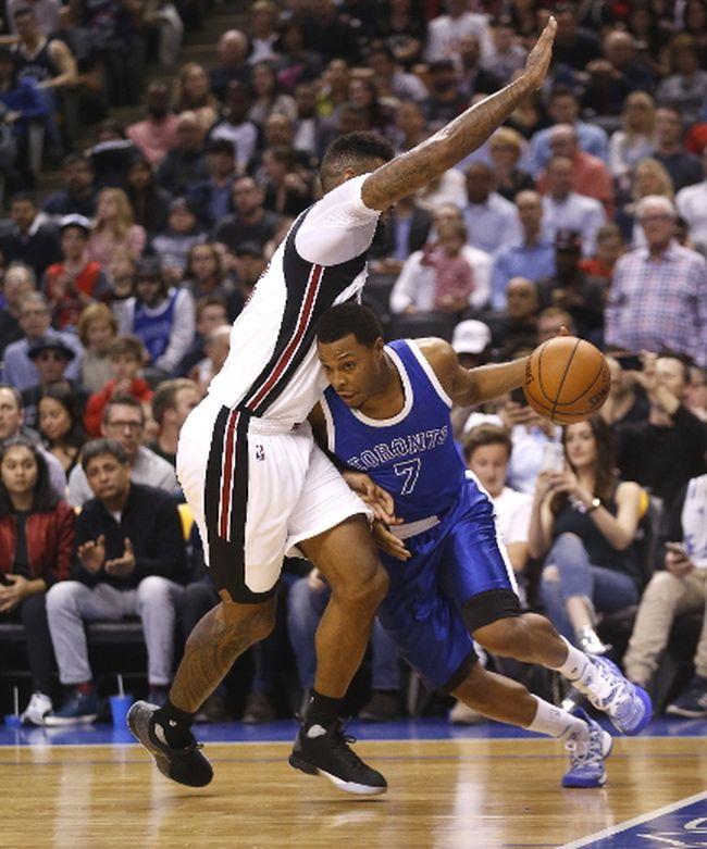 Raptors guard Kyle Lowry walks the line against Heat's James Johnson as Toronto took on Miami on April 7, 2017. (Michael Peake/Toronto Sun/Postmedia Network)