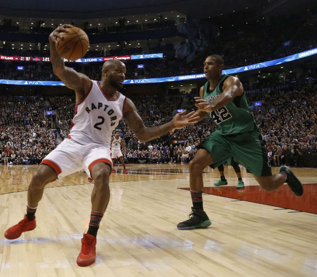 Toronto Raptors' P.J. Tucker saves a ball against Boston Celtics Al Horford during the second half in Toronto on Saturday Feb. 25, 2017. (Jack Boland/Toronto Sun/Postmedia Network)