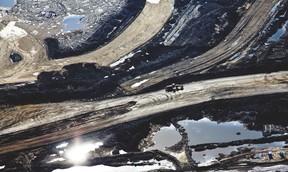 An aerial view Suncor's Millennium Mine oilsands operation north of Fort McMurray, Alta. on June 18, 2013. Ryan Jackson/Edmonton Journal/Postmedia Network