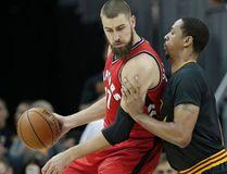 Toronto Raptors' Jonas Valanciunas drives past Cleveland Cavaliers' Channing Frye in the first half of an NBA basketball game on April 12, 2017. (AP Photo/Tony Dejak)