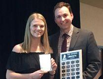 PCI Saints defender Kiera Shwaluk receives the WWHSHL WFP DIvision's top defender award at last night's awards gala in Winnipeg. (Supplied photo)