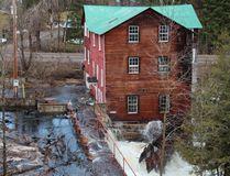 Water from Brennan's Creek floods through historic mill in Killaloe this week. (Photo by Lynn Flokstra)