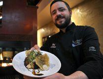 Chef Scott Wesseling of Black Trumpet presents seared scallops with orange-braised pork belly, vanilla cauliflower puree, enoki mushrooms, and tapioca coral. CHRIS MONTANINI\LONDONER\POSTMEDIA NETWORK