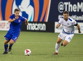 FC Edmonton midfielder Adam Straith, right, chases down Miami FC midfielder Dylan Mares in North American Soccer League play on Saturday in Miami. Miami FC won 2-0.