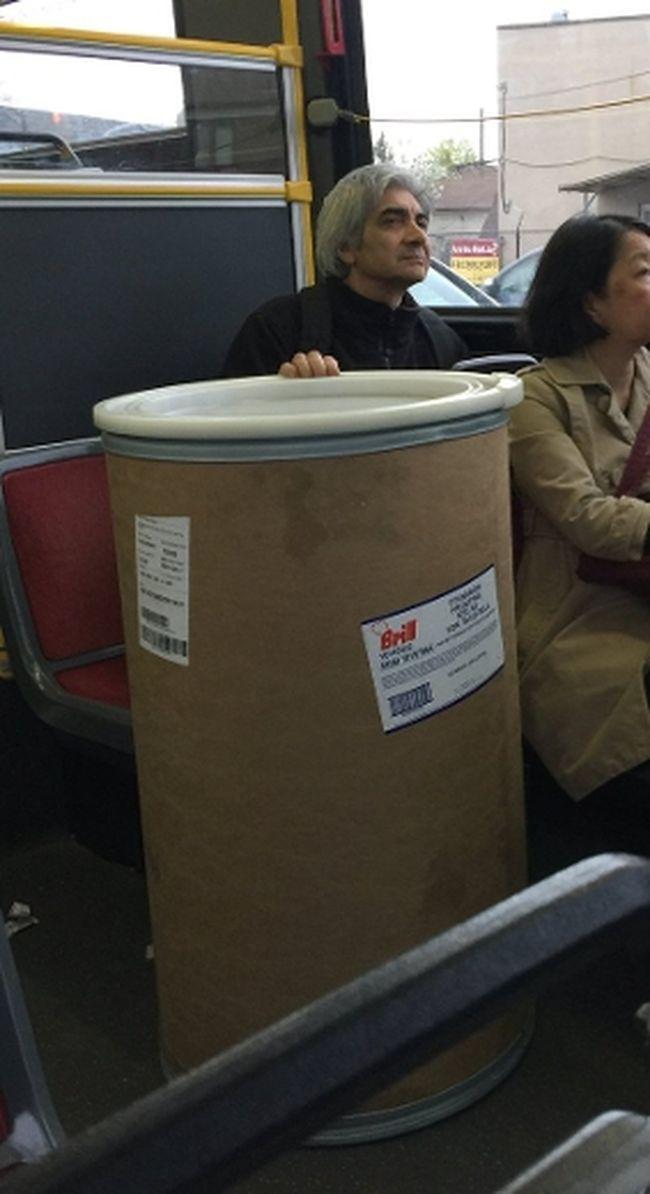 Man seen carrying a drum labelled Cinnabon icing on a TTC bus on April 28, 2017. (Craig Calhoun/Twitter)