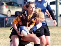 The Strathmore Spartans senior girls' rugby team won in a hard battle 36-14 against Banff on Apr. 27 at Strathmore High School. DAN MARCINKOWSKI/STRATHMORE STANDARD/POSTMEDIA NETWORK