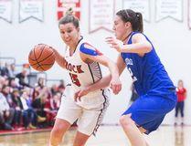 Bridget O'Reilly of the Lakehead Thunderwolves defends against Brock's Baelie Campbell in varsity basketball action in St. Catharines on Feb. 22, 2017. (Julie Jocsak/Postmedia Network)