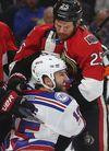 Ottawa Senators' Chris Neil tussles with New York Rangers' Tanner Glass during Game 6 on May 6, 2017. (Tony Caldwell/Postmedia)