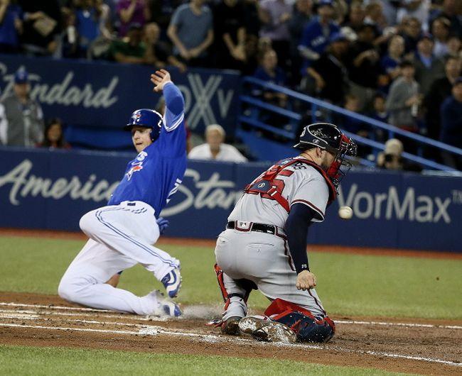 Toronto Blue Jays first baseman Justin Smoak (14) scores on Tuesday May 16, 2017. The Toronto Blue Jays host the Atlanta Braves in Toronto. Veronica Henri/Toronto Sun/Postmedia Network