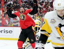 Mark Stone celebrates an Ottawa Senators goal as Pittsburgh Penguins' Sidney Crosby skates away during Game 3 at the Canadian Tire Centre on May 17, 2017. (Wayne Cuddington/Postmedia)