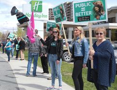 Protesters greet Ontario Premier Kathleen Wynne at the Holiday Inn in Sudbury, Ont. on Tuesday May 23, 2017. Gino Donato/Sudbury Star/Postmedia Network