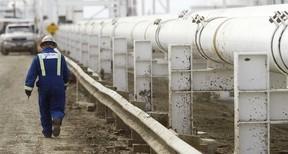 A worker walks along a new pipeline at the Enbridge facility in the east of Edmonton. (Stuart Gradon/Postmedia News)
