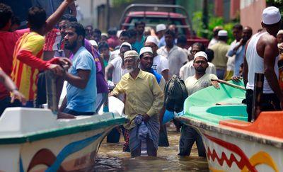 Stranded Sri Lankan flood victims wait to be evacuated at Wehangalla village in Kalutara district, Sri Lanka, Saturday, May 27, 2017.  (AP Photo/Eranga Jayawardena)