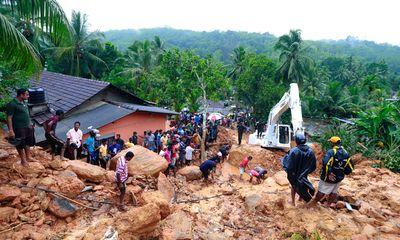 Sri Lankans watch military rescue efforts at the site of a landslide at Bellana village in Kalutara district, Sri Lanka, Friday, May 26, 2017.  (AP Photo/Eranga Jayawardena)