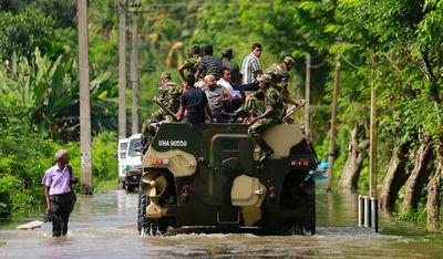 Sri Lankan army soldiers evacuate flood victims stranded at Agalawatte in Kalutara district, Sri Lanka, Saturday, May 27, 2017.  (AP Photo/Eranga Jayawardena)