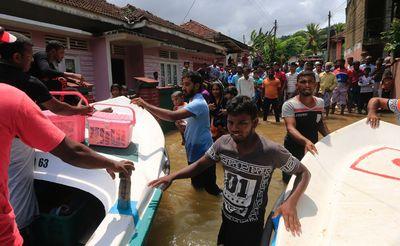 Stranded Sri Lankan flood victims waits to be evacuated at Wehangalla village in Kalutara district, Sri Lanka, Saturday, May 27, 2017.  (AP Photo/Eranga Jayawardena)