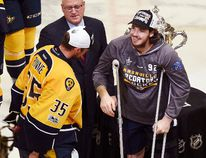 Injured Ryan Johansen celebrates with teammate Pekka Rinne of the Nashville Predators at Bridgestone Arena on May 22, 2017 in Nashville. (Sanford Myers/Getty Images)