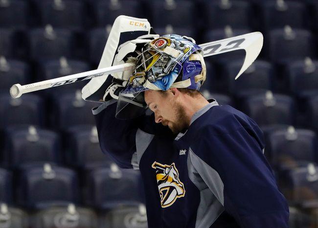 Nashville goaltender Pekka Rinne pauses during practice at Bridgestone Arena on Friday in Nashville. (AP)