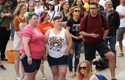 Participants listen to speeches during the 30th annual Pride Winnipeg festival rally at the Manitoba Legislative Building in Winnipeg on Sun., June 4, 2017. Kevin King/Winnipeg Sun/Postmedia Network