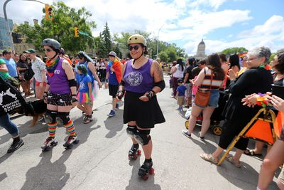 Participants march during the 30th annual Pride Winnipeg parade in Winnipeg on Sun., June 4, 2017. Kevin King/Winnipeg Sun/Postmedia Network