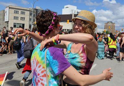 Friends reunite during the 30th annual Pride Winnipeg parade in Winnipeg on Sun., June 4, 2017. Kevin King/Winnipeg Sun/Postmedia Network