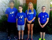 Jelvin Badua, Teague Rasmuson, Katia Rasmuson, and Kaylee Belbeck earned medals at the Lloydminster Rebels swim meet June 3.