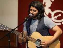 POSTMEDIA NETWORK - Artist in residence Mohsin Zaman performs at the Edmonton Folk Music Festival's 2017 media launch at Cloverdale Community Hall last Wednesday.