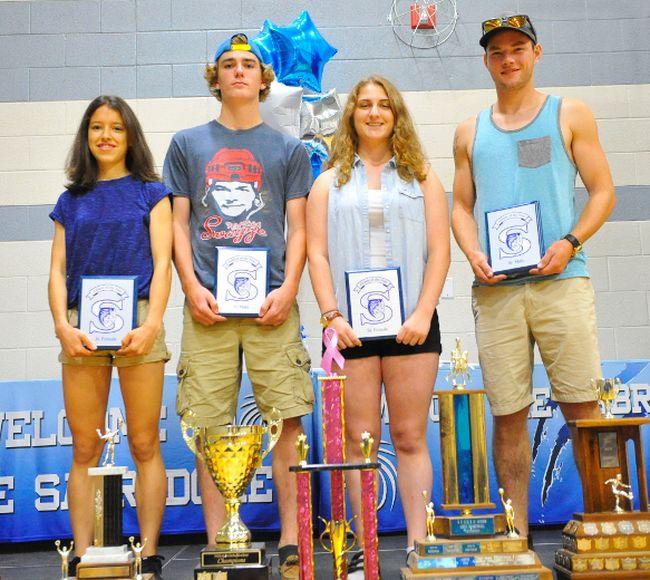 The SCS athletes of the year Michelle Goble (junior girl), Luke Erauw (junior boy), Hayley Smith (senior girl) and Tyler Kozak (senior boy) were honoured at the school's Athletic Awards Banquet Friday. JACOB ROBINSON/Simcoe Reformer