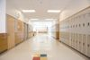 Lockers in empty high school corridor. (Getty Images)