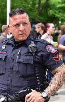 Calgary police rally city hall