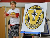 Sixth-grader Dylan Baker salutes Saint-Jean-de-Brebeuf's new flag and logo. (MORRIS LAMONT, The London Free Pess)