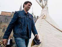 Prime Minister Justin Trudeau leaves a teepee