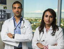 Dr. Kulvinder Gill (right) and Dr. Mark D'Souza (Ernest Doroszuk/Toronto Sun)