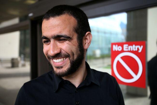 Khadr smiles