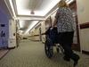 Wheelchair assistance. AL BEHRMAN / AP