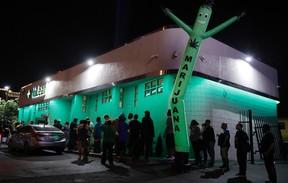 In this Saturday, July 1, 2017, file photo, people line up at the NuLeaf marijuana dispensary in Las Vegas. (AP Photo/John Locher, File)