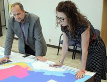 Deputy CAO and city clerk Malcolm White and deputy clerk Rachel Tyczinski review planned ward boundary changes.