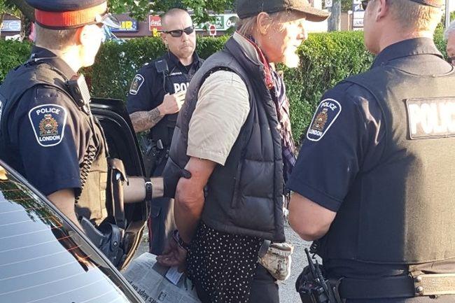 London police take a man known as Sunny James into custody. (Facebook)