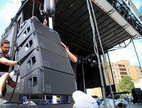 TIM MILLER/The Intelligencer A worker prepares the stage for Empire Rockfest Thursday.