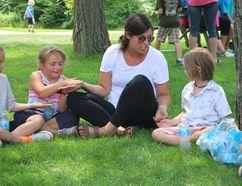Mackenzie, left, and Mia enjoy a game with fellow students and teacher Amanda Jones during a summer-learning program. (NEIL BOWEN/Sarnia Observer)