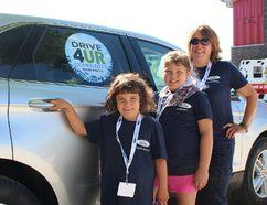 Gimli Ford's Karen Raemer, and her children Rae-Ann (8) and Brae-Lynn Charrier (6), participated in the Ford Drive 4 UR Community event July 15. (Juliet Kadzviti/The Interlake Spectator/Postmedia Network)