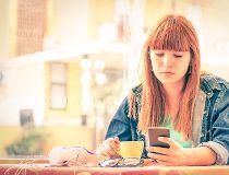 woman sits alone