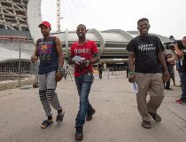 Asylum seekers from Haiti leave Olympic Stadium