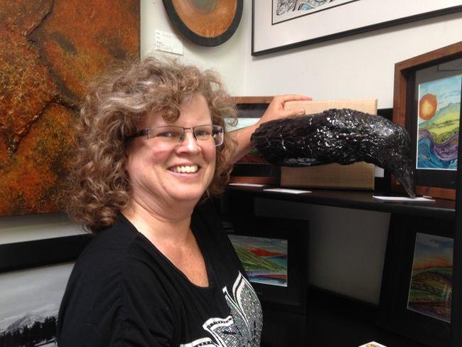 Local artist Margot Soltice showing her artwork.