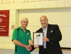 Marcel Dube (left) received the outstanding volunteer award Wednesday, August 9.